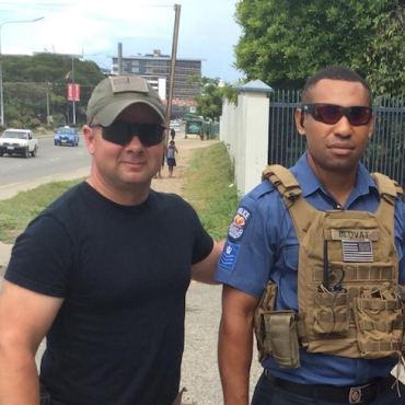 Stephen Blovat mentors a member of the PNG Federal Police Force. Photo courtesy LA+SG